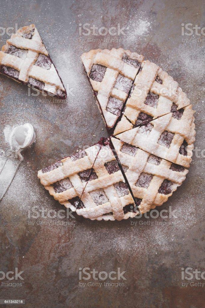 Lattice top cherry pie with powdered sugar stock photo