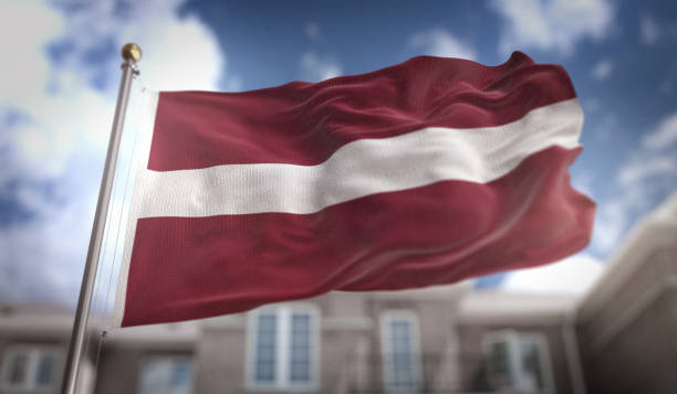 Latvia Flag 3D Rendering on Blue Sky Building Background stock photo