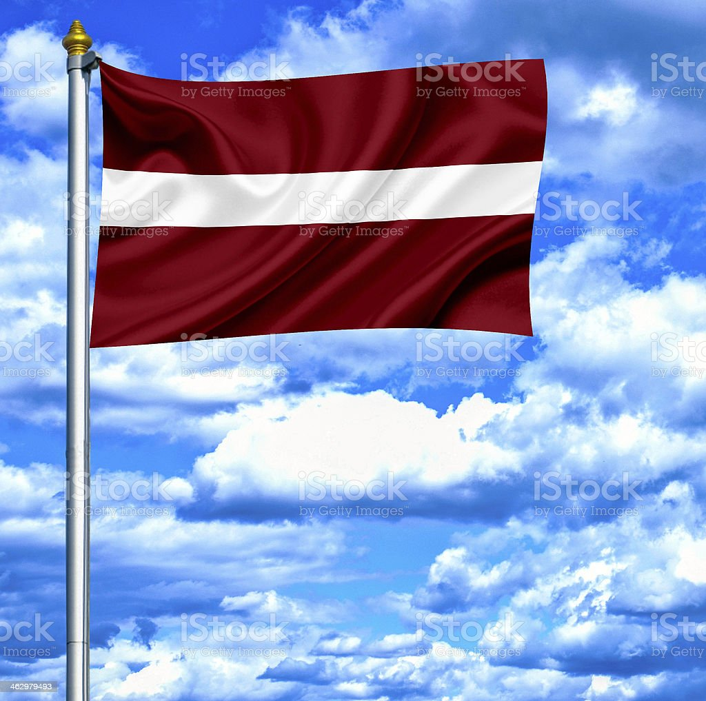 Latvia waving flag against blue sky stock photo