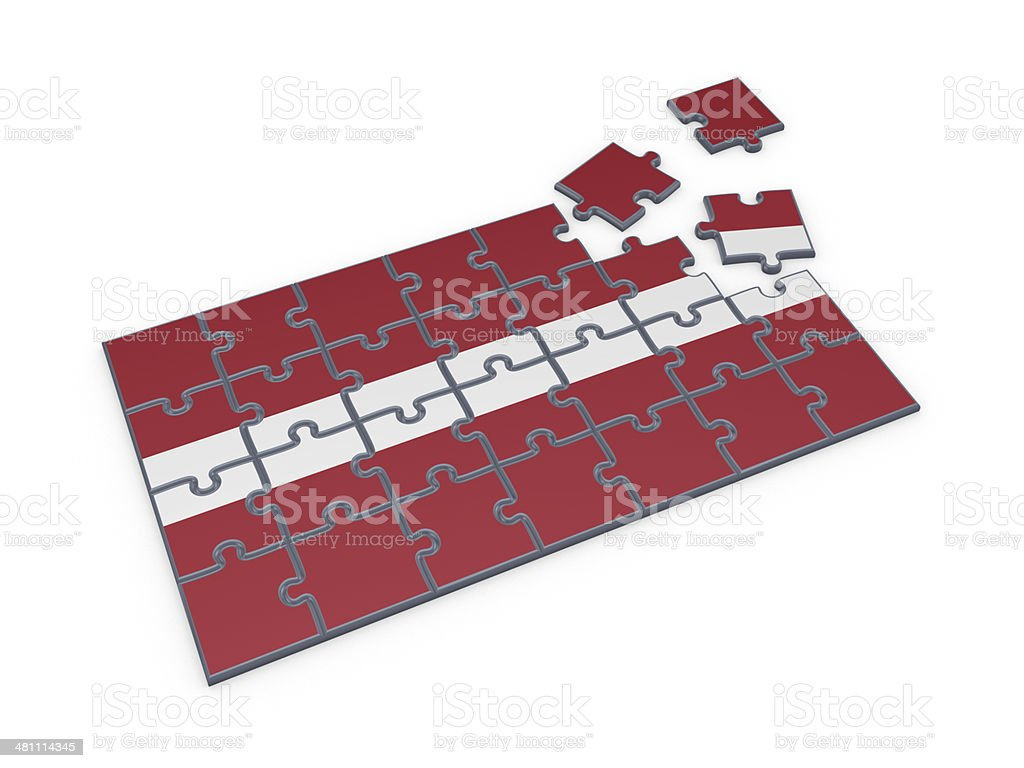 Latvian flag made of puzzles. stock photo