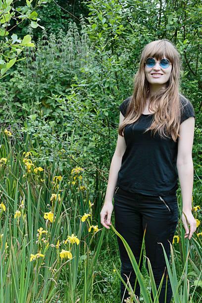 yellow iris latvian outdoor girl marshy background - whiteway latvian outdoor girl stock photos and pictures