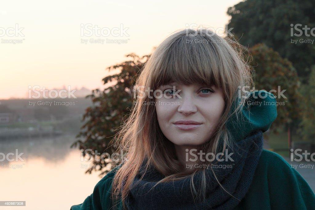 Latvian outdoor girl Hampton Court Bridge London morning mist stock photo