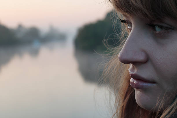 latvian outdoor girl profile hampton court bridge london mist - whiteway latvian outdoor girl stock photos and pictures