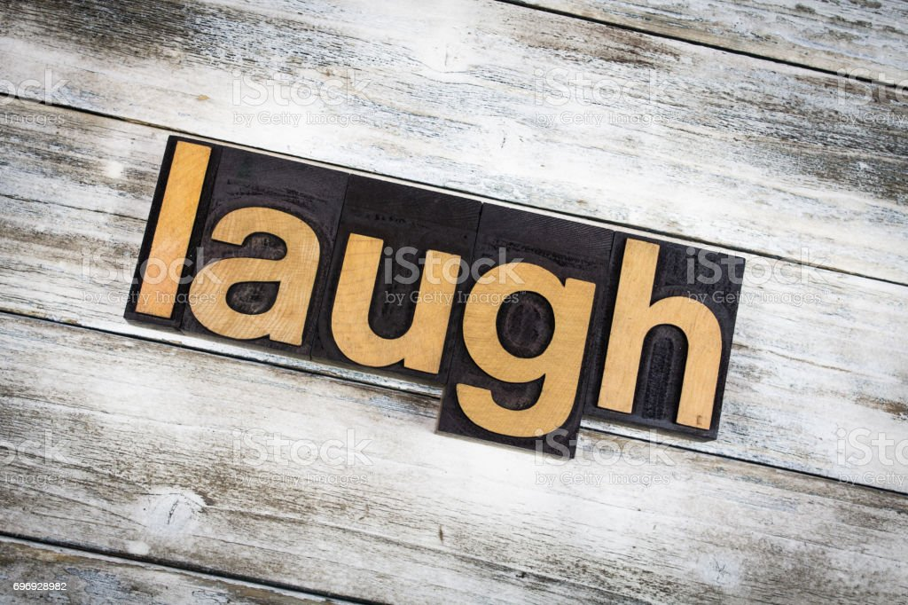 Laugh Letterpress Word on Wooden Background stock photo