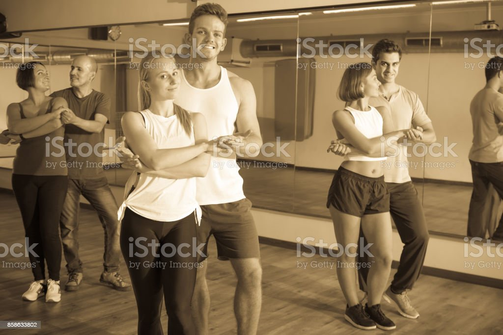 Laughing adults dancing bachata together stock photo