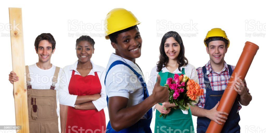 Laughing african american construction worker with group of other workers royalty-free stock photo