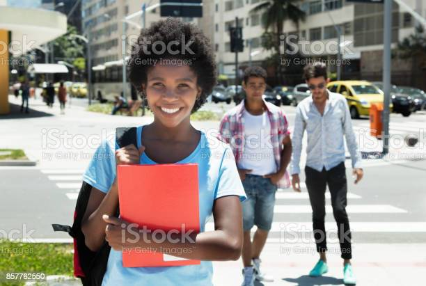 Laughing african american female student in the city picture id857762550?b=1&k=6&m=857762550&s=612x612&h=krpbe tksk79vbrt40psyivu6dgtfbazmhc7akmv6e4=