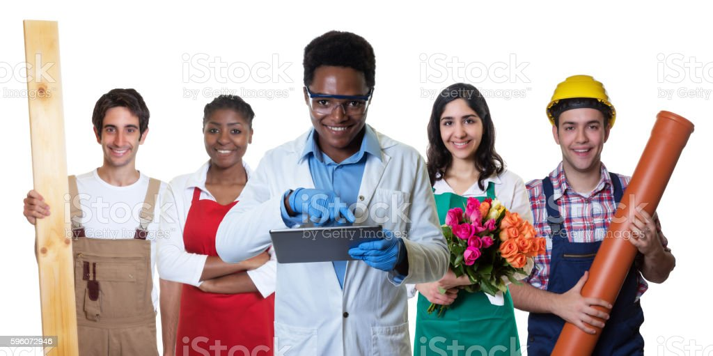 Laughing african american scientist with group of other international apprentices royalty-free stock photo