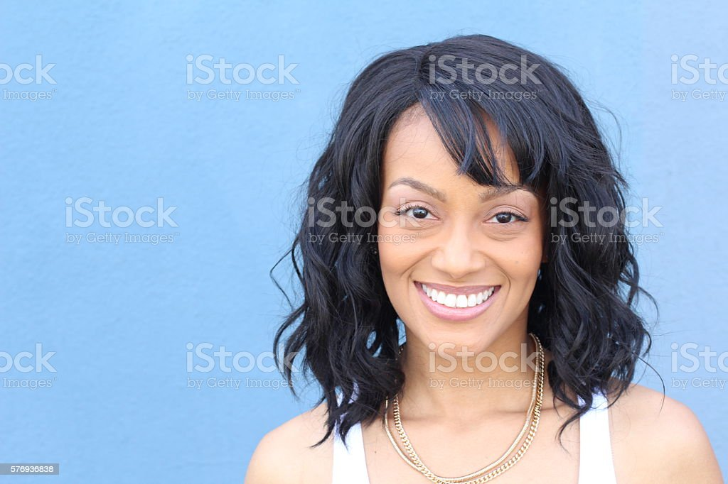 Laughing African American woman with an wavy hairstyle stock photo
