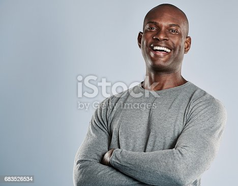 istock Laughing African man in gray shirt with copy space 683526534