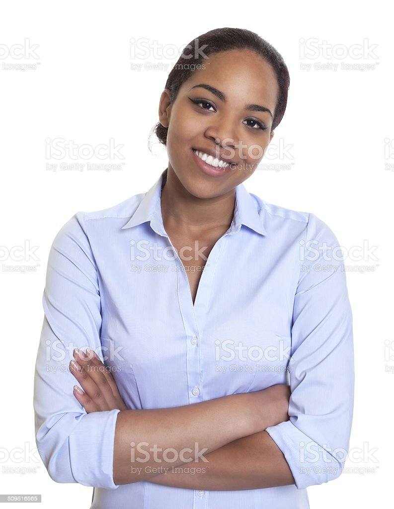 Laughing african woman in a blue shirt with crossed arms stock photo