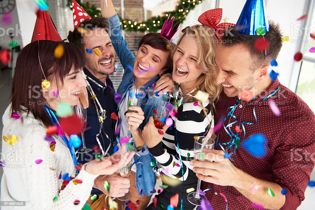 Laughing and celebrating the new years eve stock photo