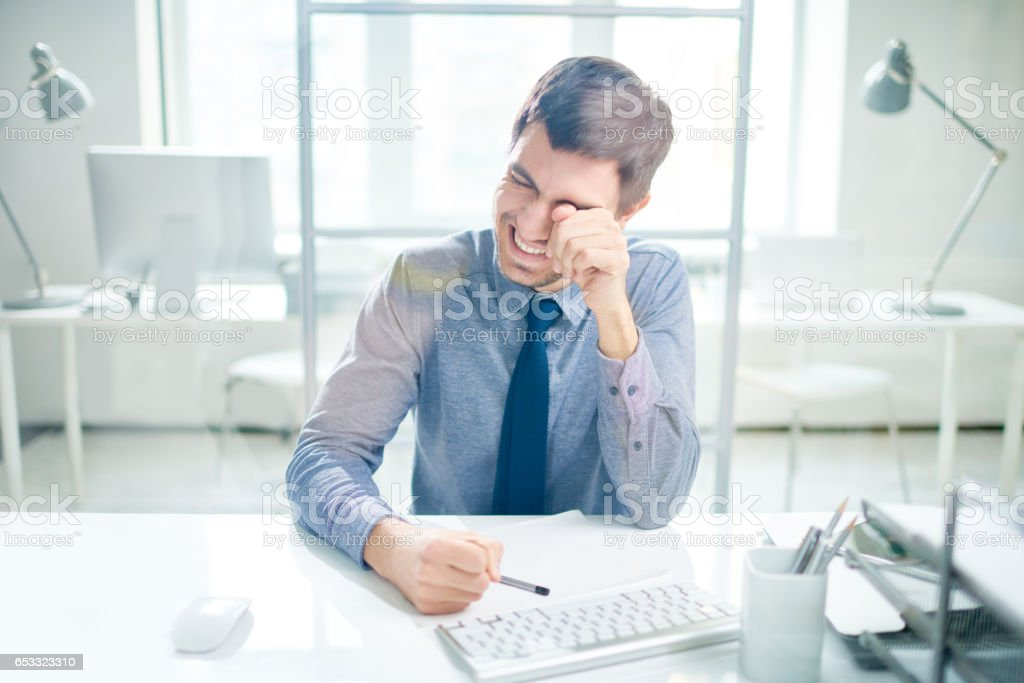 Laughing and crying businessman stock photo