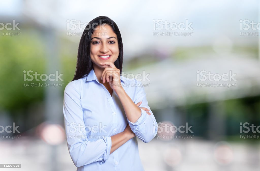 Laughing arabic businesswoman looking at camera stock photo