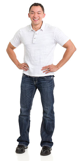 Laughing Asian Man With Hands On Hips Portrait of a young man on a white background. http://s3.amazonaws.com/drbimages/m/pg.jpg akimbo stock pictures, royalty-free photos & images