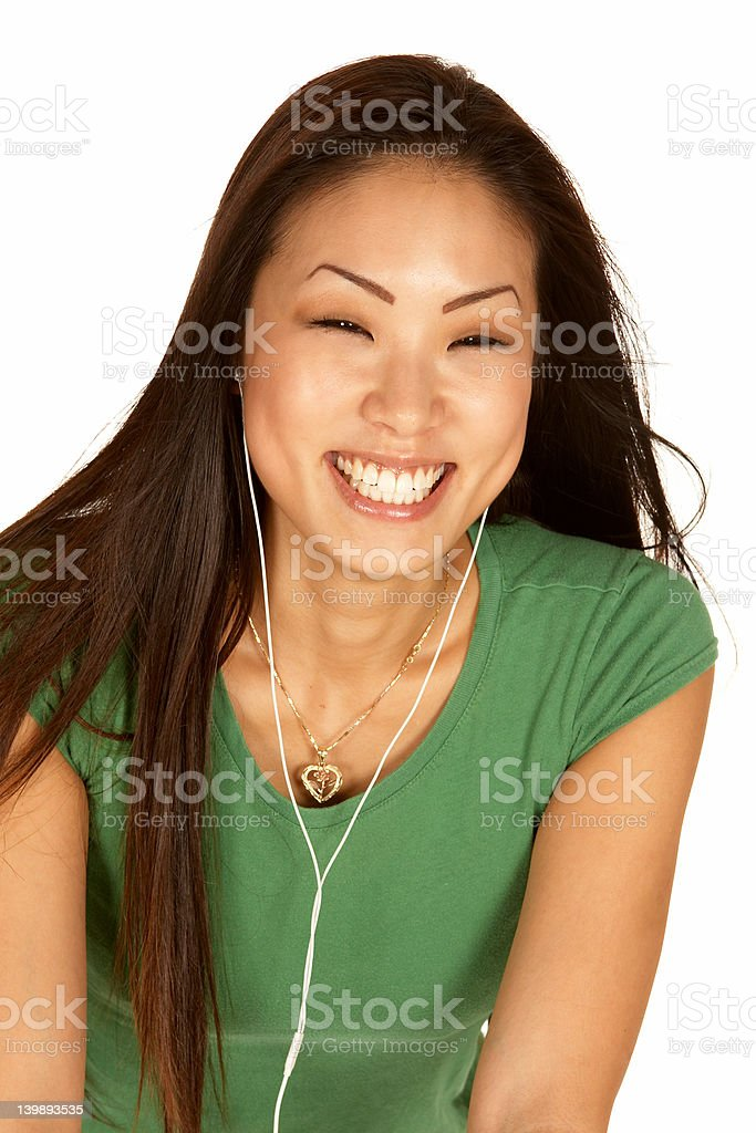 Laughing Asian Woman with Ear Buds royalty-free stock photo