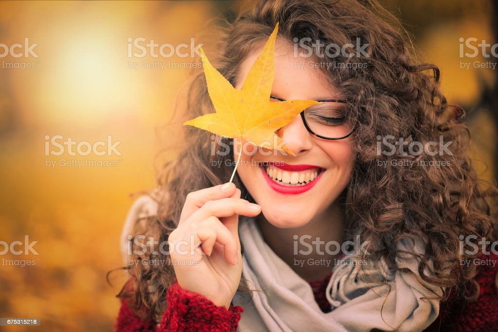 Laughing at autumn stock photo