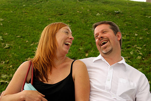 laughing at the park - mikefahl stock pictures, royalty-free photos & images
