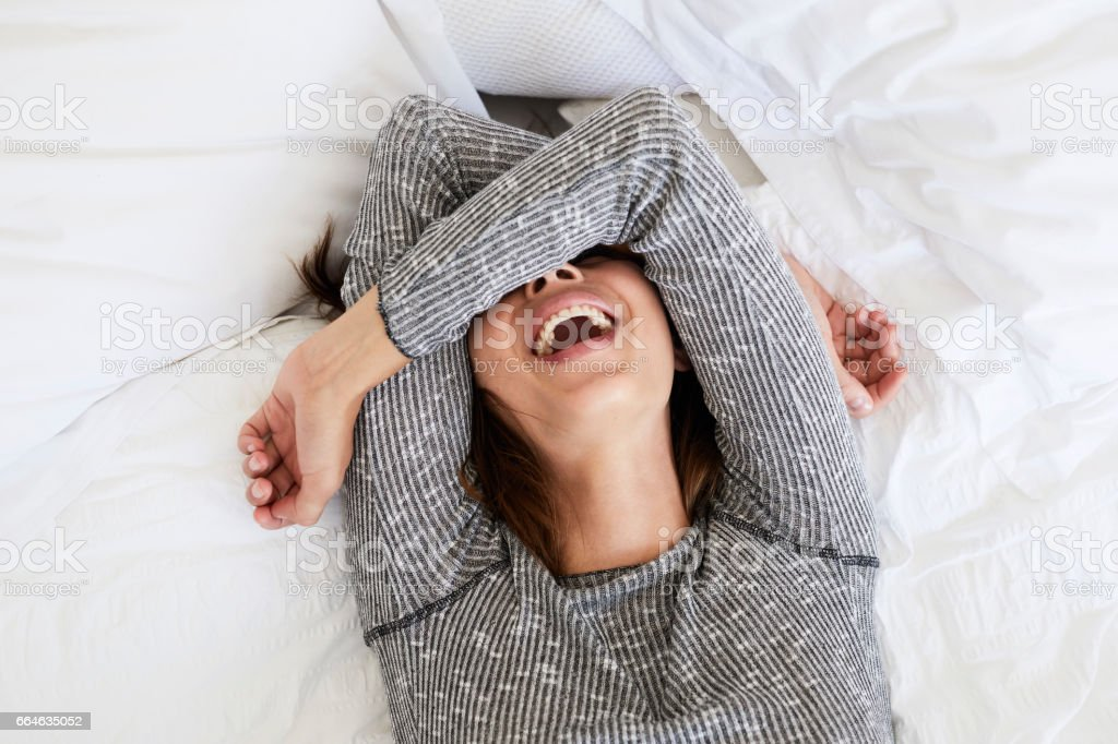 Laughing babe in bed stock photo