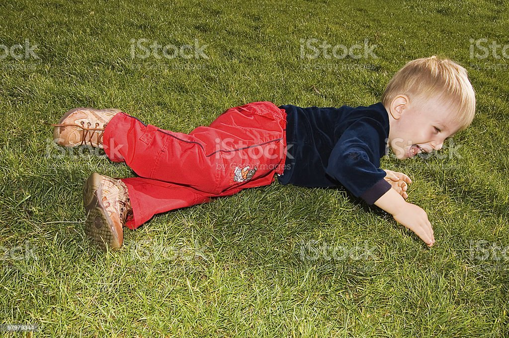 laughing baby boy are on the grass royalty-free stock photo