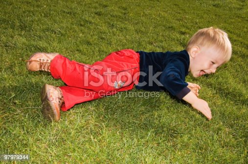 Laughing Baby Boy Are On The Grass Stock Photo & More Pictures of 12-23 Months