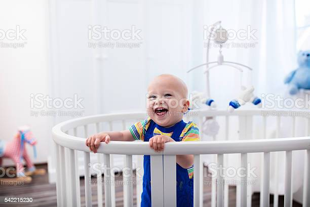 Laughing baby boy standing in bed picture id542215230?b=1&k=6&m=542215230&s=612x612&h=dfep3gvmier2nra0erzlajlj9ur0aelm2tfagklfpn4=