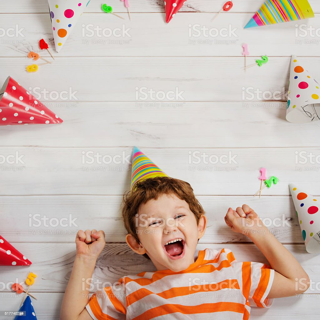 Laughing baby on carnival party. stock photo