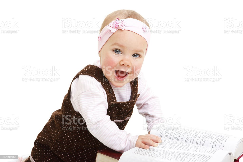 Laughing baby with book royalty free stockfoto