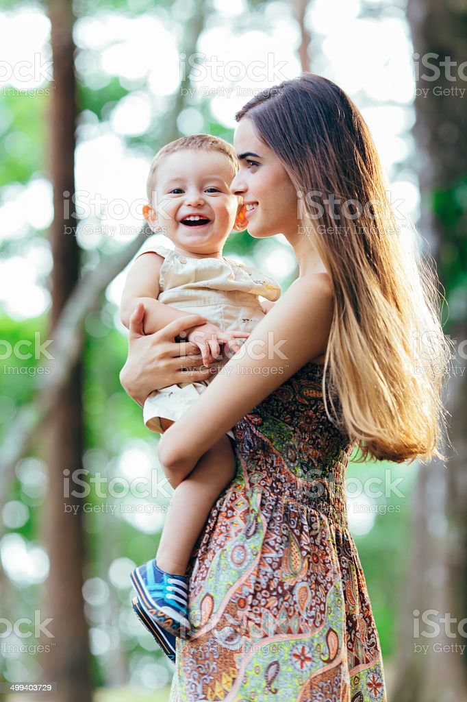 Laughing baby with young mother stock photo