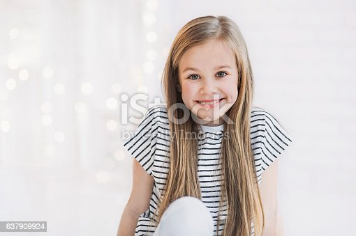 istock Laughing beautiful girl portrait 637909924