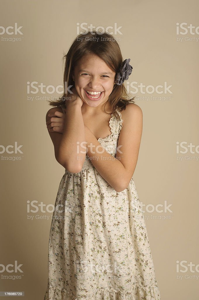 Laughing Beautiful Little Girl Wearing a Flower in Her Hair royalty-free stock photo