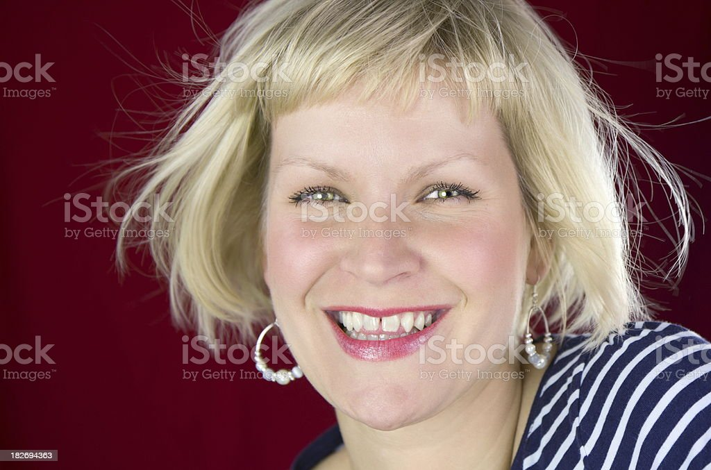 Laughing beautiful woman with unperfected teeth stock photo
