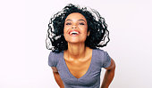 istock Laughing beauty. Close-up fashion photo of laughing young African ethnic woman leaning towards camera and holding her hands on her hips. 1180642191