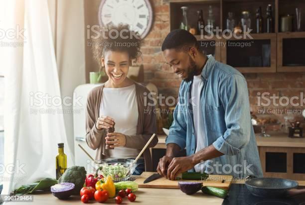 Laughing black couple preparing salad in kitchen picture id996179464?b=1&k=6&m=996179464&s=612x612&h=q0id2s qytbzomfxpnp6n5lmfrjlbrpwvchfg7wmu10=