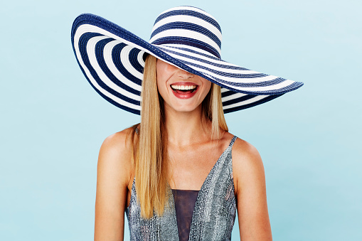 Laughing blond in summer hat