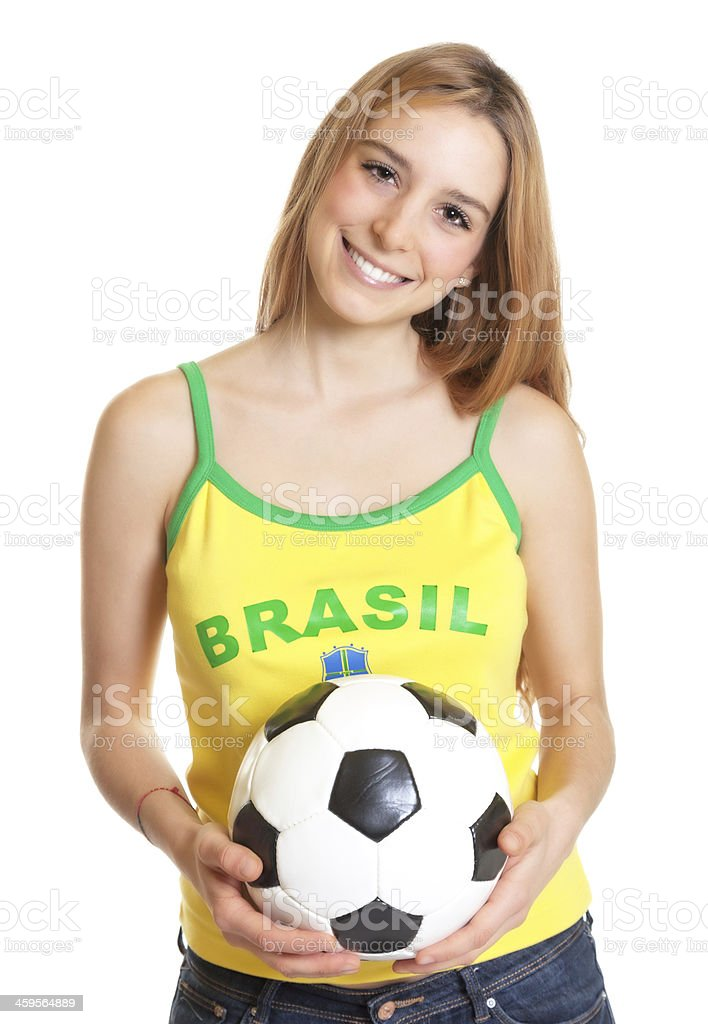 Laughing brazilian sports fan with ball royalty-free stock photo