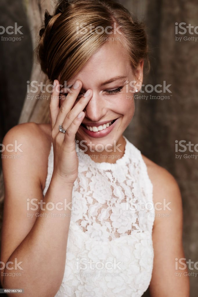 Laughing bride in wedding dress