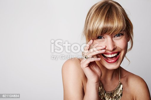 istock Laughing bride with wedding ring, portrait 621104834