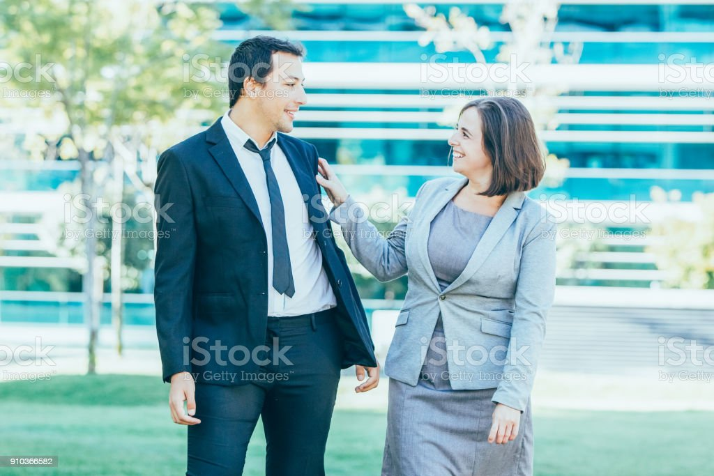Closeup portrait of laughing middle-aged business man and woman...