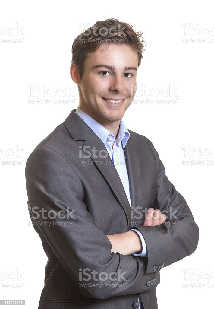 Laughing businessman with crossed arms stock photo