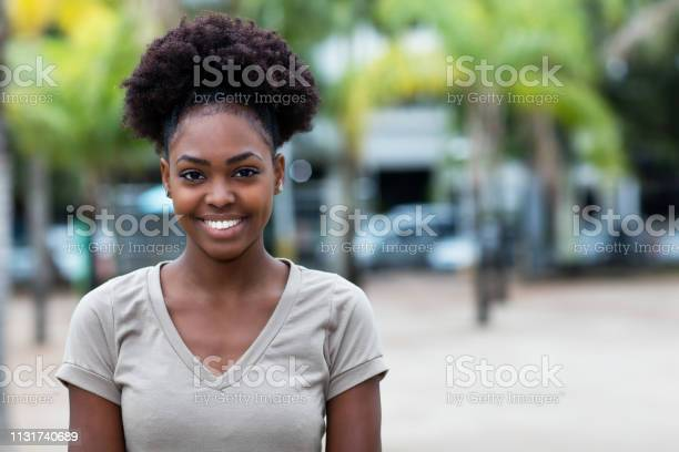 Laughing caribbean woman with afro hair picture id1131740689?b=1&k=6&m=1131740689&s=612x612&h=mh4dljdlr2 fqhvschoncrxeqwcoxa8ahj3kn0fmmj0=