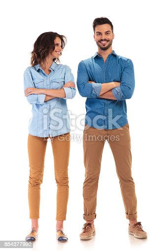 istock laughing casual woman with hands crossed looks at her boyfriend 854377992