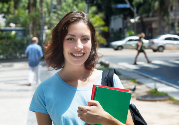 Laughing caucasian female student in the city stock photo