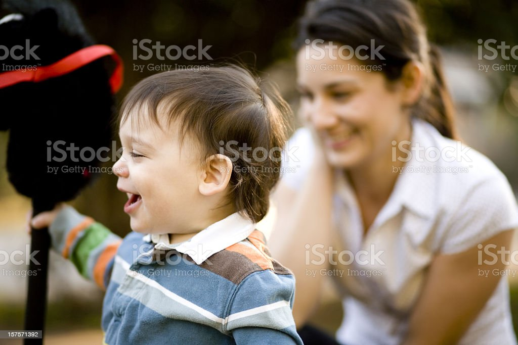 Laughing child and woman royalty-free stock photo