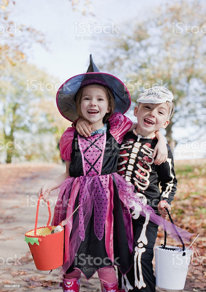 Laughing children in Halloween costumes stock photo