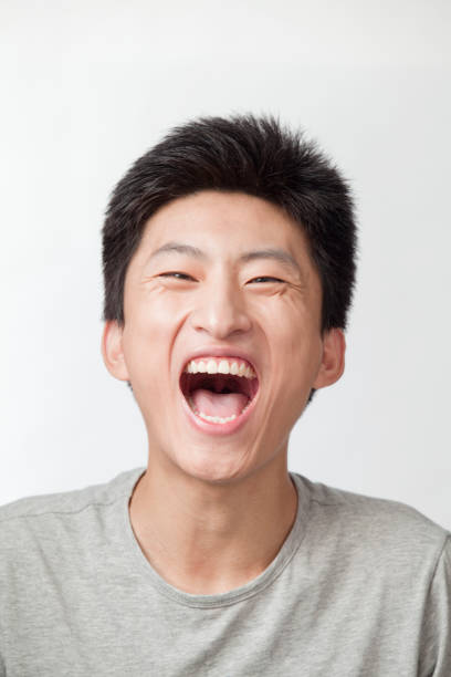 Laughing Chinese man Laughing Chinese man mouth open stock pictures, royalty-free photos & images
