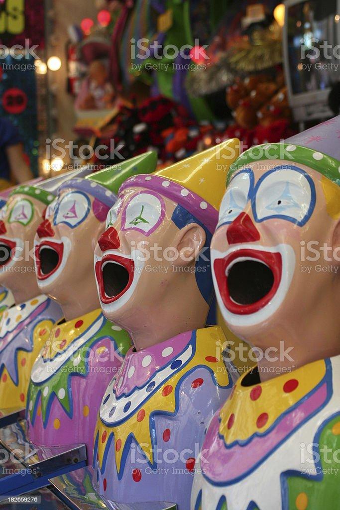 Laughing clowns at an amusement park royalty-free stock photo