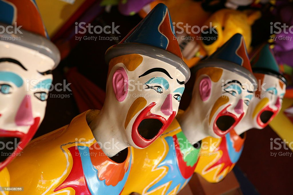 Laughing clowns game at an amusement park royalty-free stock photo