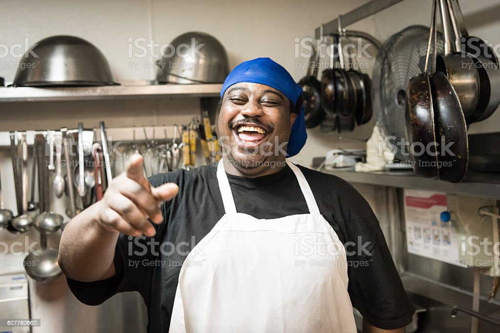 Laughing cook stock photo