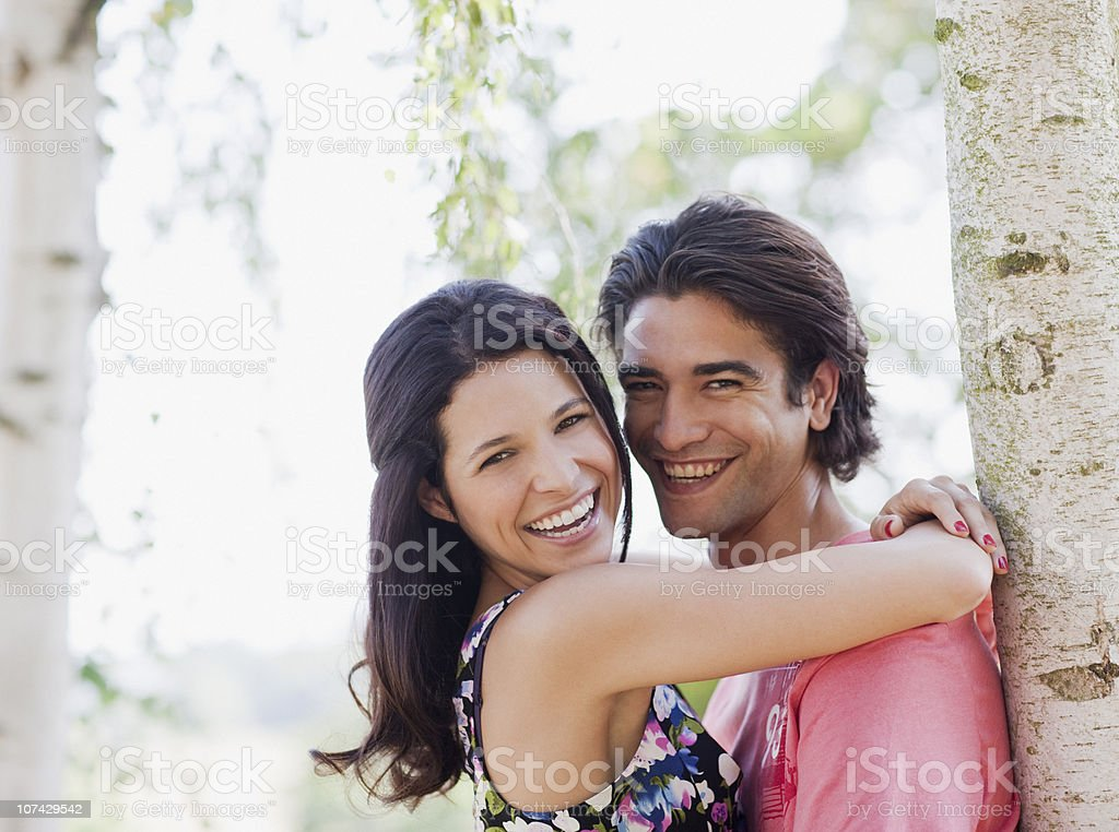 Laughing couple hugging outdoors royalty-free stock photo